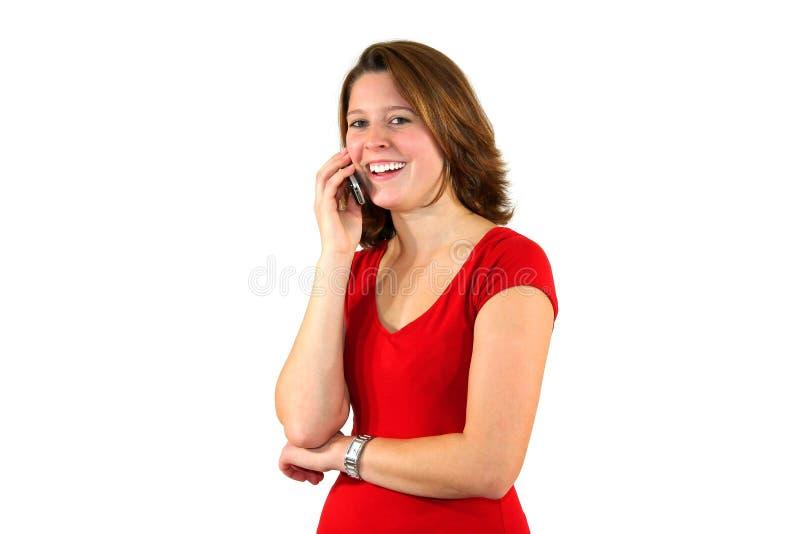 Lächelnde schöne Frau, die auf Handy behandelt lizenzfreies stockfoto