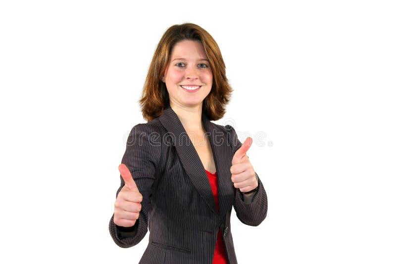 Lächelnde schöne Geschäftsfrau mit den Daumen oben lizenzfreie stockfotografie