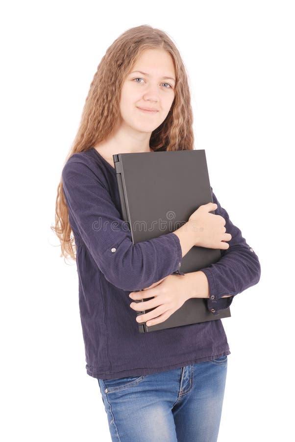 Lächelnde Studentenjugendliche mit Laptop stockfotografie