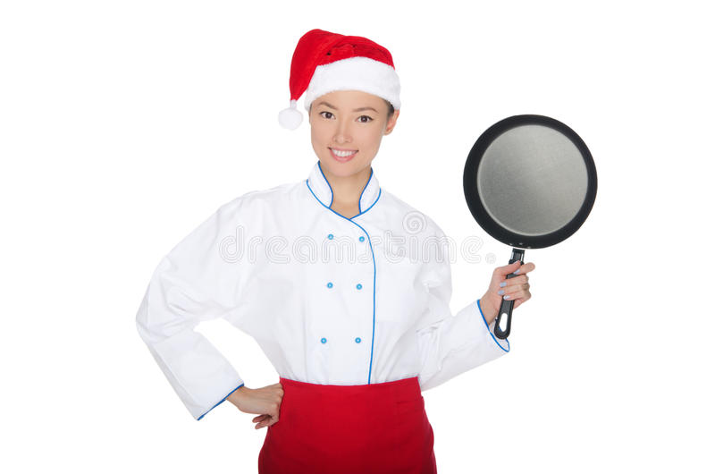 Lächelnder asiatischer Chef mit Bratpfanne und Weihnachtshut stockbild