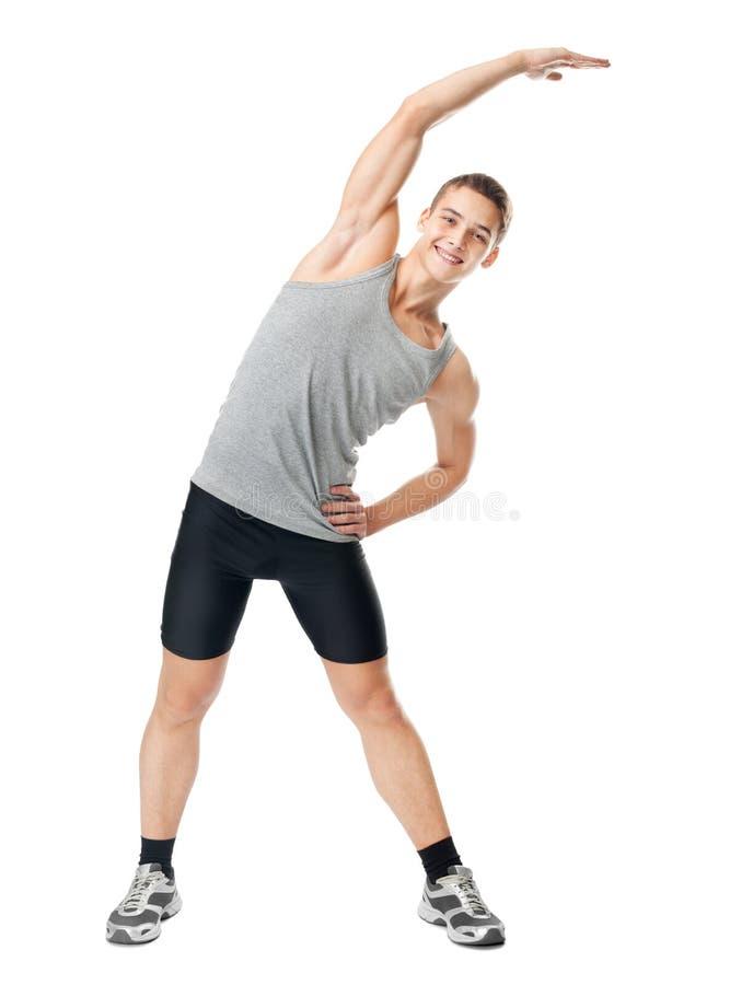 Lächelnder Athlet, der Übungen tut lizenzfreies stockbild