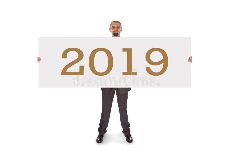 Lächelnder Geschäftsmann, der eine wirklich große leere Karte - 2019 hält stockbilder