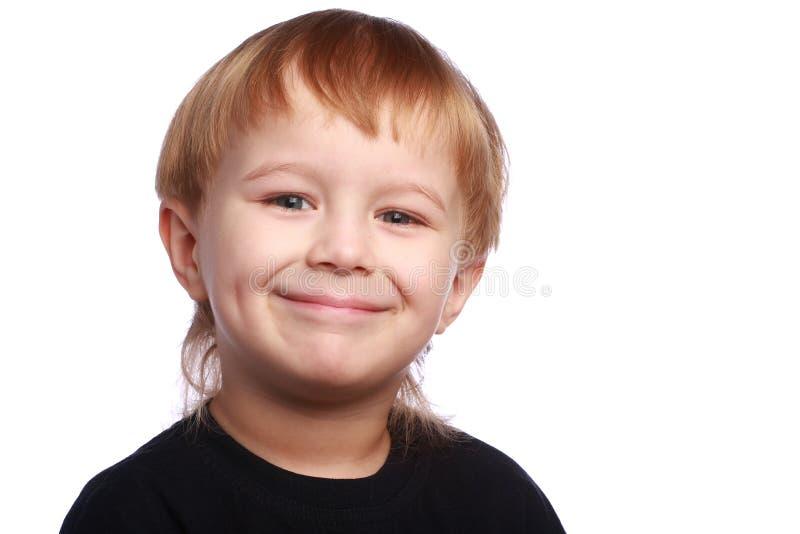 Lächelnder junger Junge stockbild