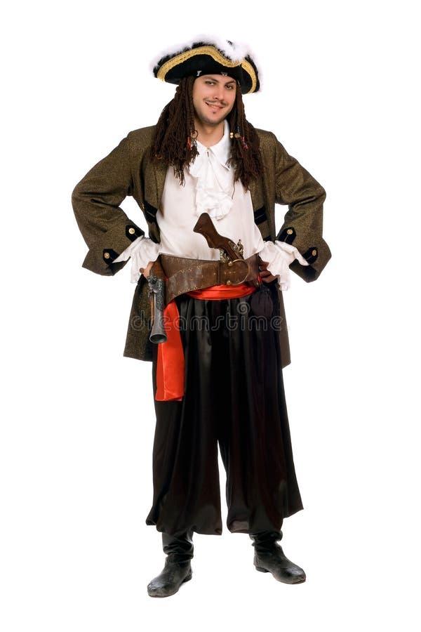 Lächelnder junger Mann in einem Piratenkostüm stockbilder