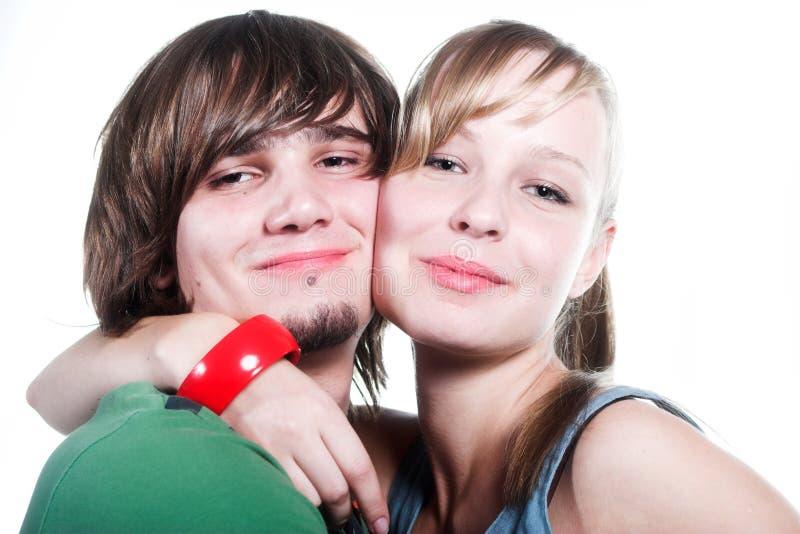 Lächelnder stattlicher Kerl und Mädchen stockfotos