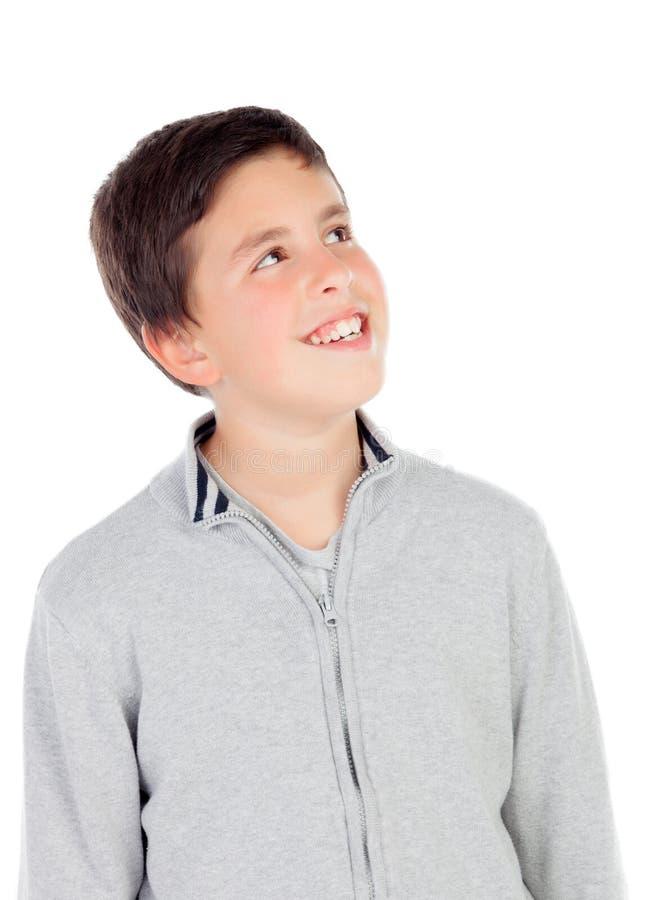 Lächelnder Teenager von dreizehn oben schauend stockfotos