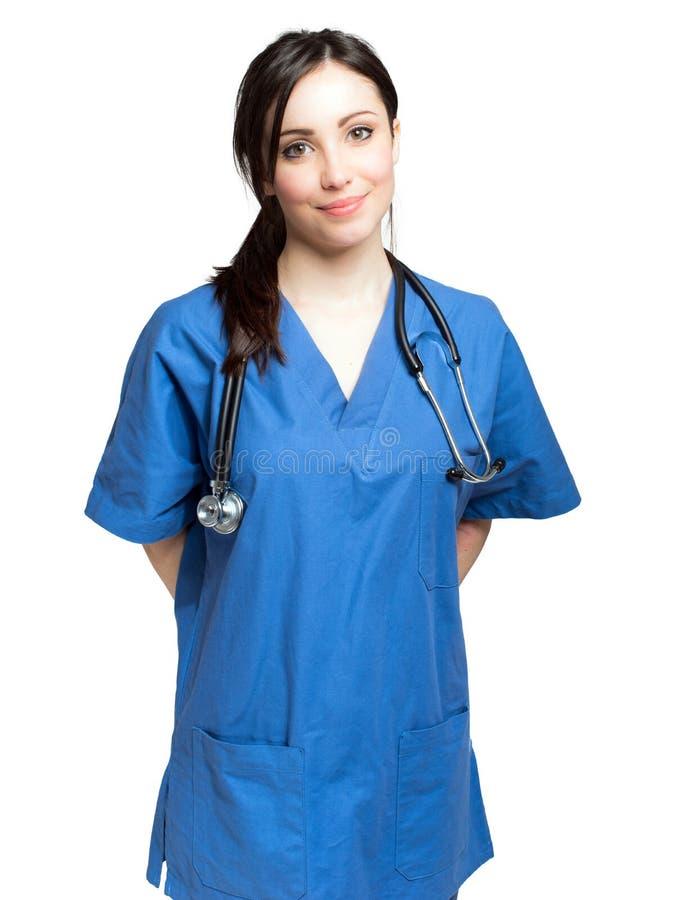 Lächelnder weiblicher Doktor auf weißem Hintergrund stockbild