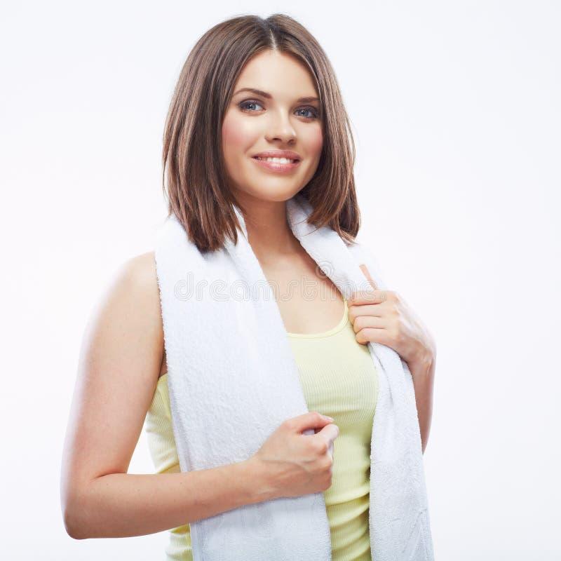 Lächelndes Eignungsmädchen, das Tuch lokalisiert auf weißem Hintergrund hält lizenzfreies stockbild