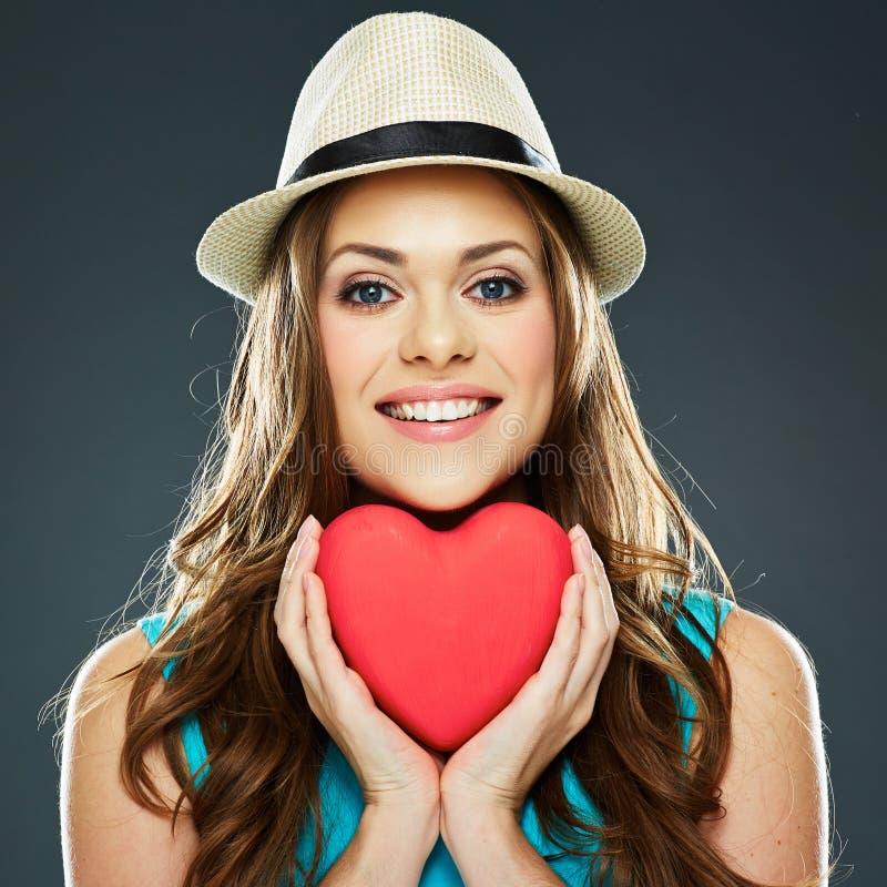 Lächelndes Frauen-Gesicht Rotes Herz Valentinsgruß d lizenzfreie stockbilder