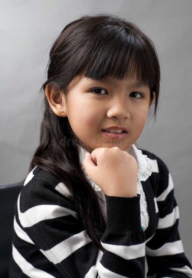 Lächelndes Gesicht des Mädchens lizenzfreies stockbild