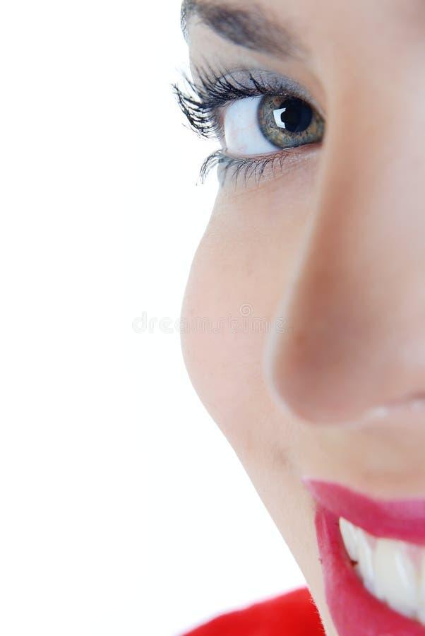 Lächelndes halbes Gesicht lizenzfreies stockfoto