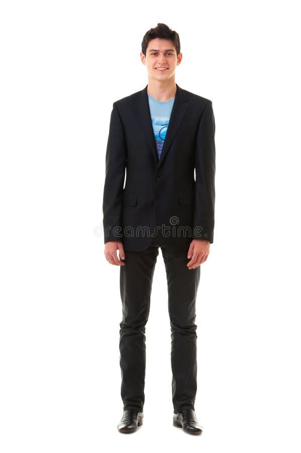 Lächelndes junges Geschäftsmann in voller Länge lokalisiert auf weißem backgro lizenzfreie stockfotografie
