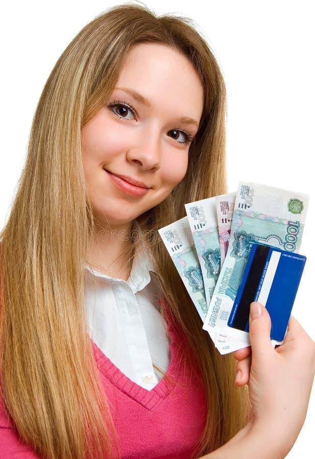 Lächelndes Mädchen mit Geld und Kreditkarte stockfotografie