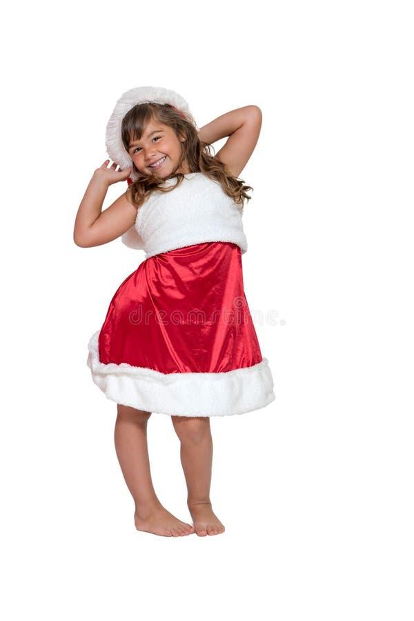 Lächelndes nettes kleines Mädchen in Santa Claus-Kostüm lokalisiert stockfotografie