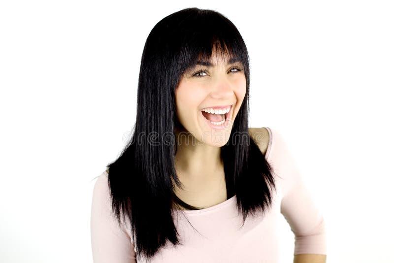 Lächelndes schönes glückliches des jungen Mädchens lokalisiert lizenzfreie stockbilder