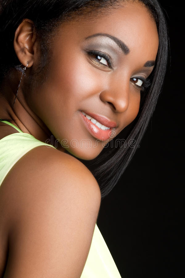 Lächelndes schwarzes Mädchen lizenzfreie stockbilder