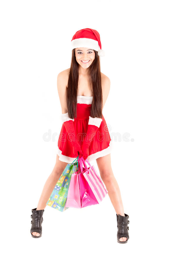 Lächelndes Weihnachtseinkaufenmädchen auf weißem Hintergrund. lizenzfreies stockbild
