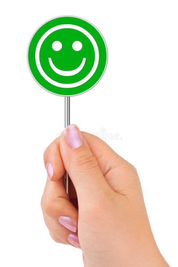 Lächelnzeichen in der Hand lizenzfreies stockfoto