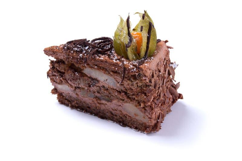 Läcker chokladkaka som isoleras på vit royaltyfri bild