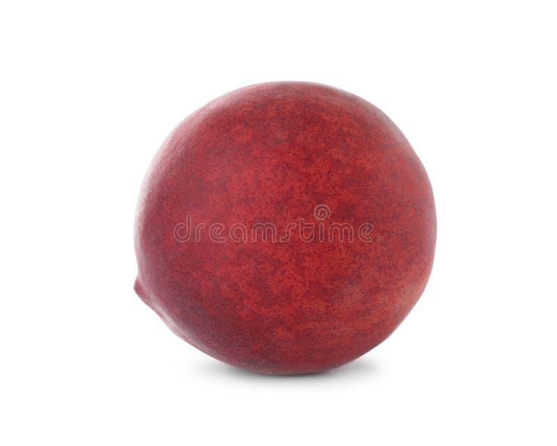 Läcker mogen söt persika på vit royaltyfri fotografi