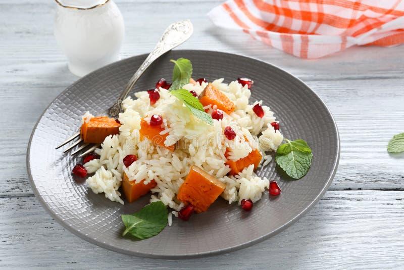 Läckra ris med söt pumpa och mintkaramellen arkivfoto