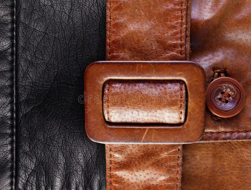 Läder med en kutabakgrund royaltyfri fotografi