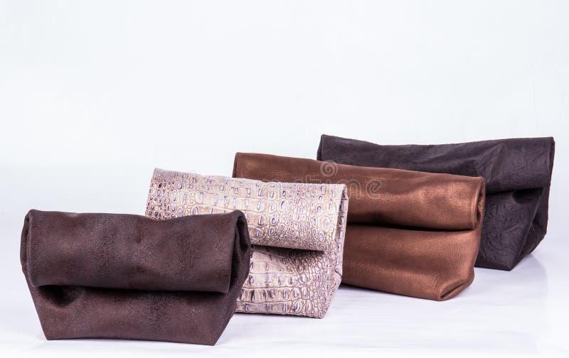 Läderhandväska på en vit bakgrund fotografering för bildbyråer