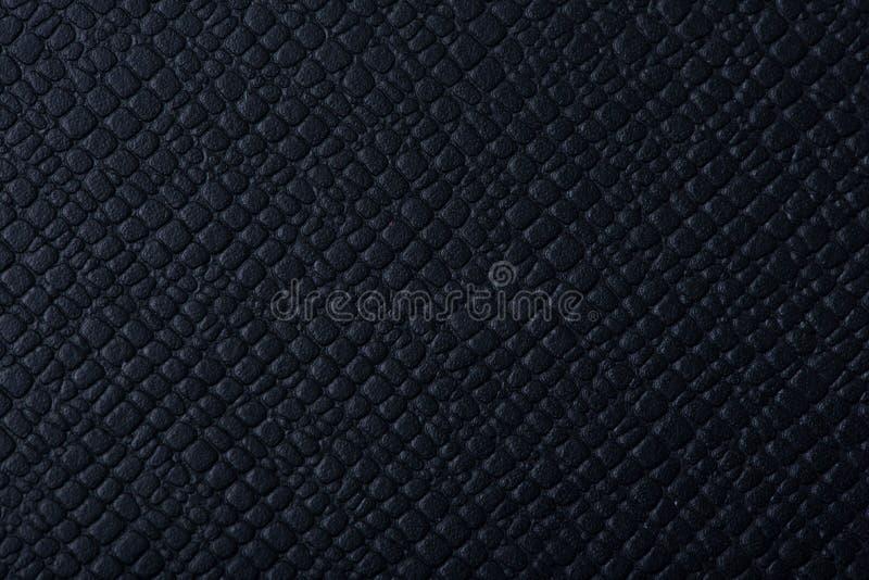 LäderKINDLE skyddande muff på texturen royaltyfri bild