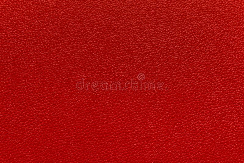 Lädertextur eller bakgrund för närbild röd royaltyfria foton