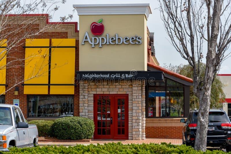 Läge för galler och för stång för grannskap för Applebee ` s arkivfoto