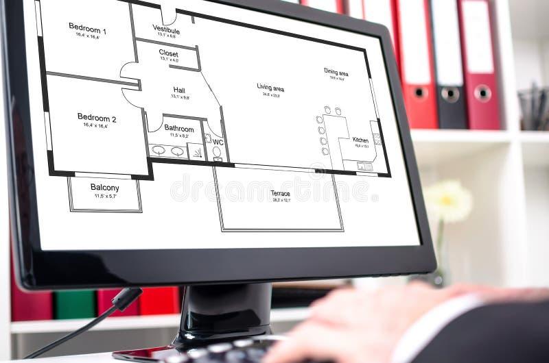 Lägenhetplanbegrepp på en datorskärm royaltyfria foton