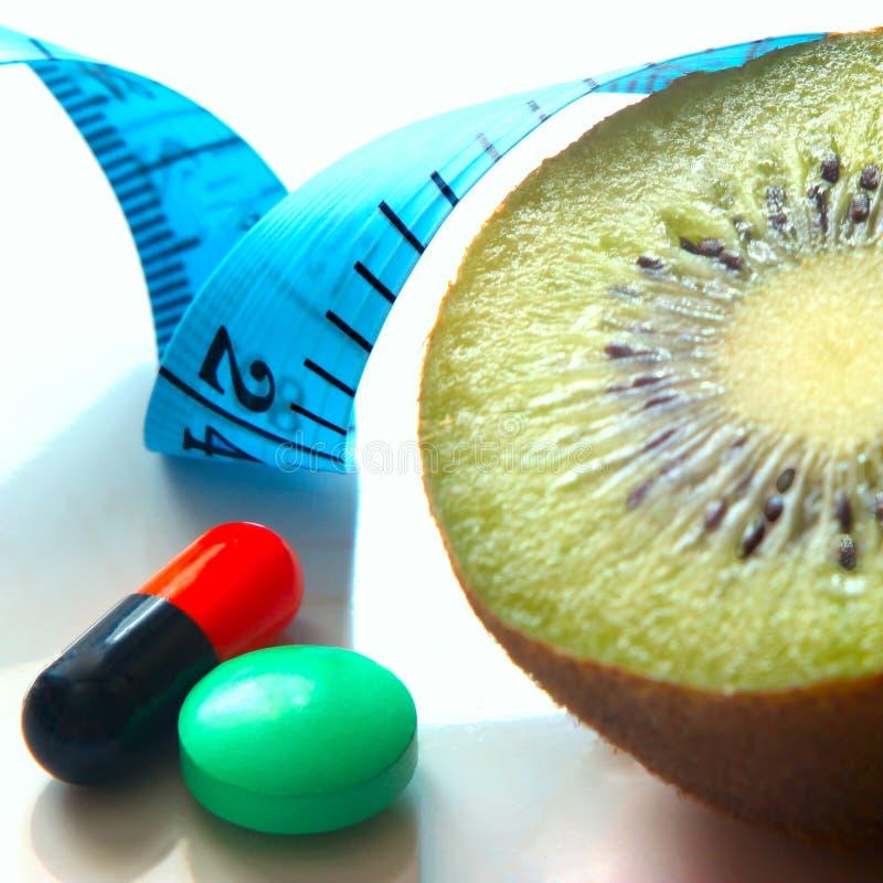 Läkarbehandling för viktförlust, meter - en apparat för att mäta längd royaltyfria foton