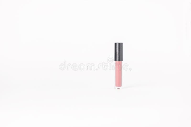 Läppstift blänker det rosa röret som isoleras på vit bakgrund royaltyfri foto