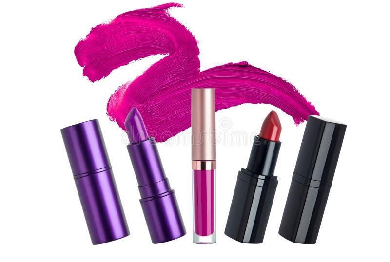 Läppstiftskönhetsmedel utgör gåvauppsättningen royaltyfri fotografi