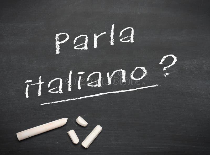 Lära språket - italienare arkivbild