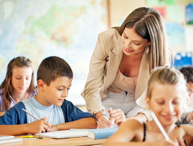 Lärare och studenter arkivbilder
