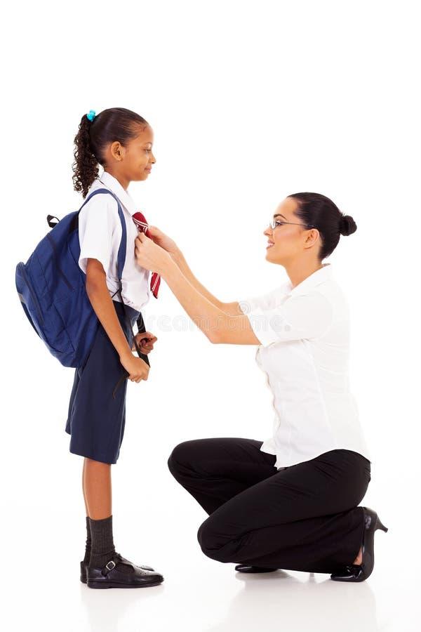 Lärareportionschoolgirl royaltyfria foton