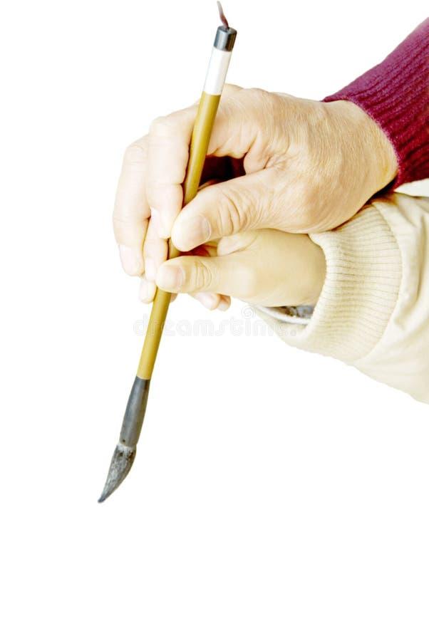 lärer den kinesiska fadern för calligraphybarnet att undervisa arkivfoto