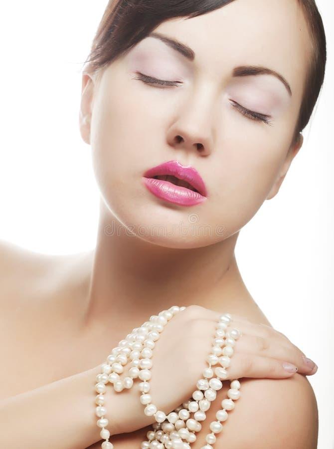 Lärmfrau mit Perle stockbild