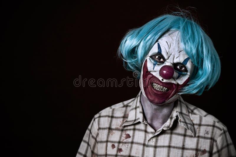 Läskig ond clown royaltyfri bild