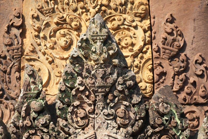 Lättnader i Banteay Srei i Siem Reap, Cambodja royaltyfri bild