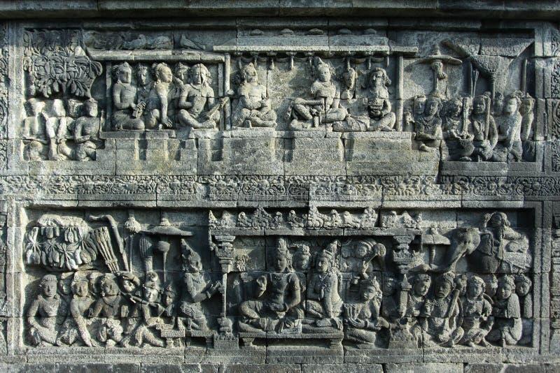 Lättnadsskulpturer i Borobudur royaltyfria foton