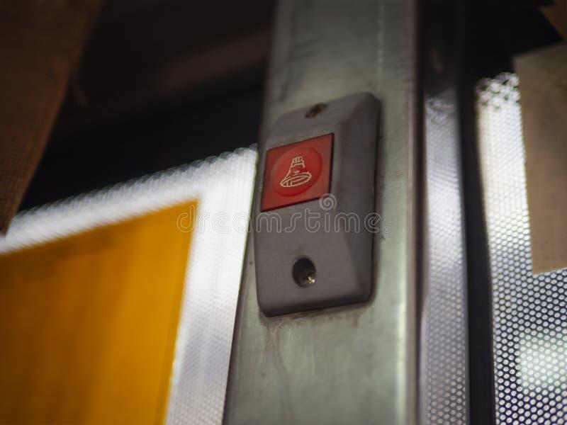 Låg vinkel av den röda stoppknappen på den bangkok bussen royaltyfri fotografi