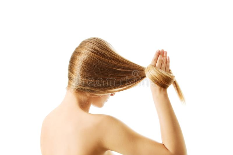 Lång blond närbild för mänskligt hår royaltyfria bilder