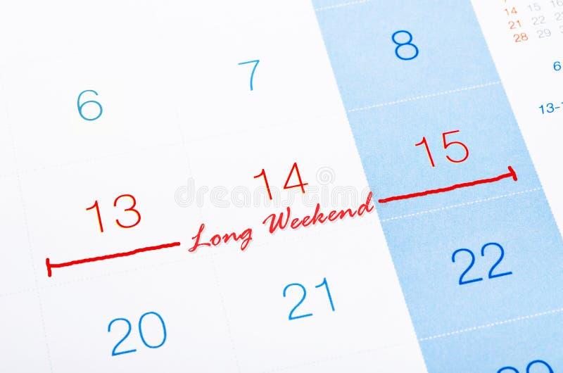 Lång helg på kalendersidan arkivbilder