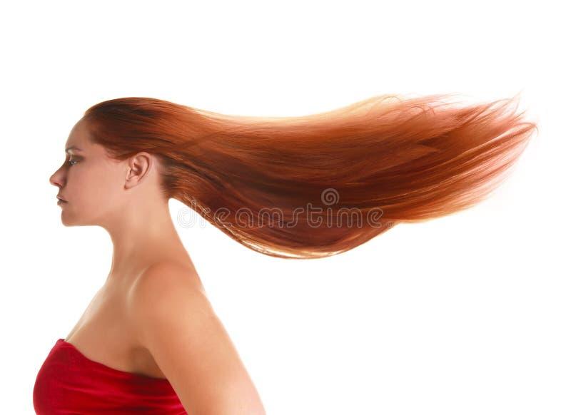 lång röd kvinna för hår arkivfoto