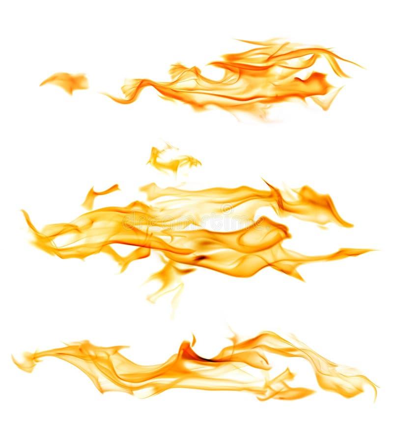 Långa gnistor för gul flamma som isoleras på vit fotografering för bildbyråer