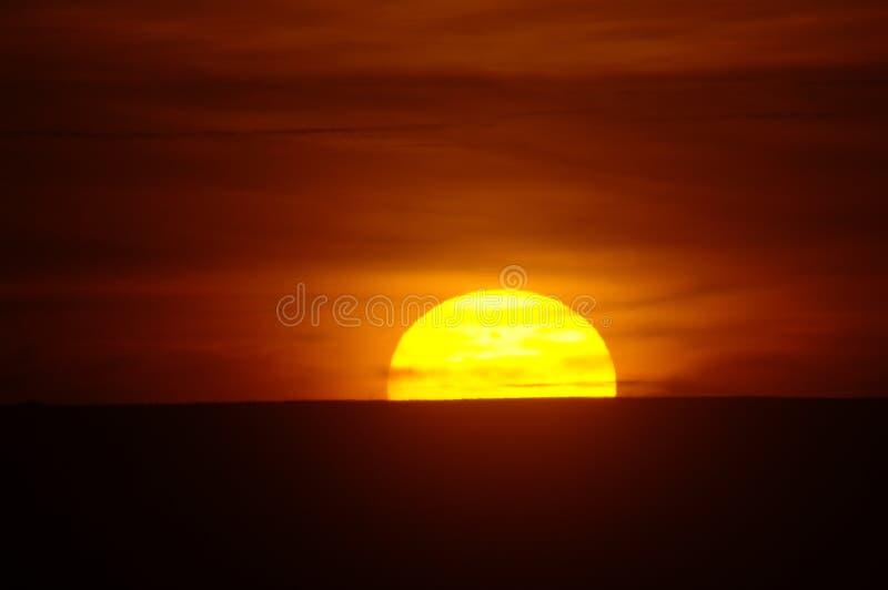 Långsam solnedgång royaltyfria foton