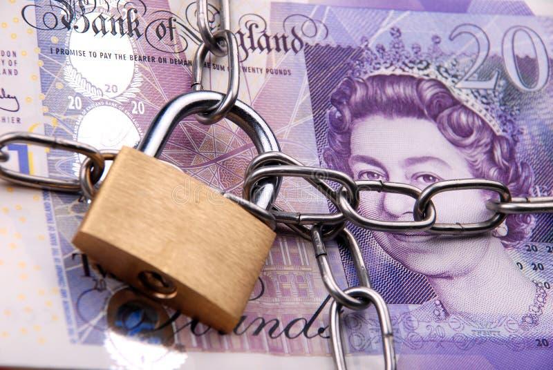 låsta pengar arkivfoton