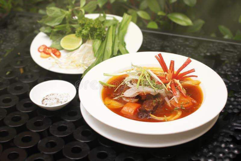Låtit småkoka Saigon nötkött (BÃ-²khoen) royaltyfri fotografi